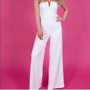 Brand new with tags white kittenish jumpsuit sz M